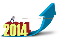 Man pulls 2014 on arrow sign. Young asian man is pulling 2014 with chain on arrow sign Royalty Free Stock Images