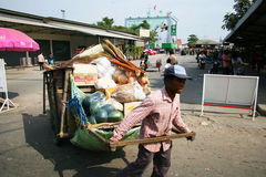 Man pulls a cart, Thailand. Royalty Free Stock Image
