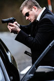 Man pulls a gun in car Royalty Free Stock Photos