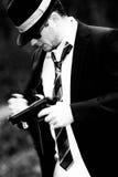 Man pulls a gun. In a mixed environment, like james bond Royalty Free Stock Image