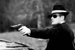 Man pulls a gun. In a mixed environment, like james bond Royalty Free Stock Photo
