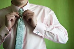 Man pulls his tie Stock Image
