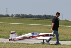 Man pulls Model Airplane Stock Image