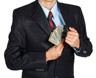Man pulls money out of his jacket Royalty Free Stock Image