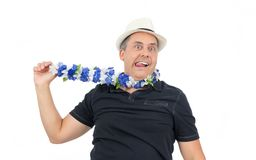 Man pulls the necklace of flowers, hanging himself. He is overwe. Crazy man pulls on the necklace as if to hang himself. He is bald and is wearing white hat and Stock Photography