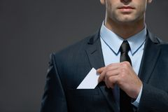 Man pulls out business card from the pocket stock images