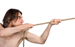 Man pulls a rope. Stock Photos