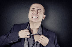 Tight tie. A man pulls a tight tie Stock Images
