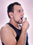 A man with pump in his mouth Royalty Free Stock Photos