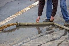 Free Man Pumping Away Flood Water 2 Stock Photos - 42258193