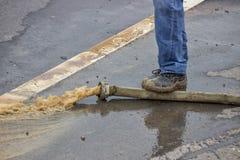 Man pumping away flood water 3 Stock Image