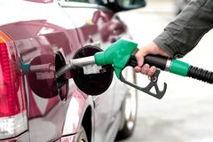Man Pumping fuel in to the tank Stock Photo
