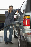 Man Pumping Gas Into Car Stock Photo