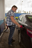 Man pumping Gas at the Gas Station Stock Photos