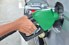 A man pumping gas in to the tank Stock Photography
