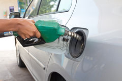 Man pumping gas in to the tank Stock Image