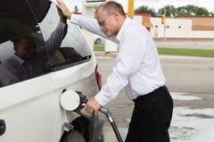 Man pumping gas into vehicle. Royalty Free Stock Image