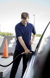 Man pumping gasoline Royalty Free Stock Images