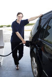 Man pumping gasoline Stock Photos