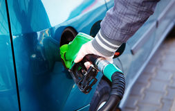 Man pumping gasoline fuel in car at gas station. transportation concept Stock Photos