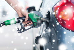Man pumping gasoline fuel in car at gas station. Transportation and ownership concept - man pumping gasoline fuel in car at gas station stock images