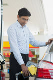 Man pumping gasoline fuel Stock Photos