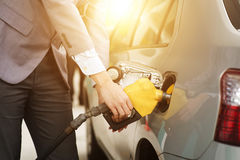Man pumping petrol. Refilling gas. Close up of man pumping gasoline fuel in car at petrol station stock photo