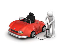 Man pumping red cabrio's tyre Stock Image