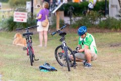 Man pumping up the tires on his bike, editorial. royalty free stock photos