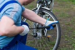 Man pumping wheel bike Royalty Free Stock Photos