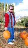 Man with pumpkin Stock Photo