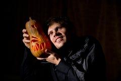 Man with pumpkin Stock Image