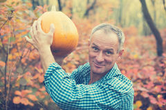 Man with pumpkin in hands enjoying life Royalty Free Stock Photography