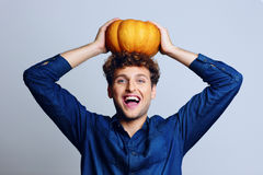 Man with pumpkin on head Stock Photos