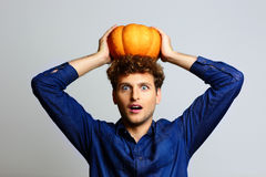 Man with pumpkin on head Royalty Free Stock Photos