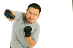 Man punch in body combat. A man is exercise in punch position Isolated Portrait Stock Photo
