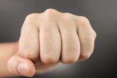 Man Punch fist on black Stock Photo