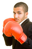 Man punching. Young business man with red boxing gloves Stock Images