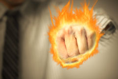 Man punching with fist of fire Stock Photography