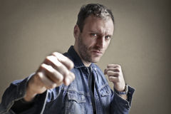 Man punching royalty free stock image