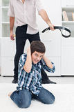 Man punishing his son Royalty Free Stock Images