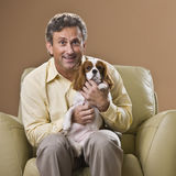 Man with Puppy Royalty Free Stock Image