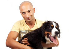 Man with puppy bernese mountain dog. On the white background stock photos