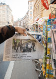 Man purchases Die Welt newspaper from press kiosk after London a Stock Image