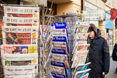 Man purchases a International press newspapers from a newsstand Stock Photos