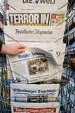Man purchases a Kehler Zeitung  newspaper from press kiosk after Stock Photo