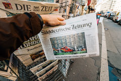 Man purchases Süddeutsche zeitung  newspaper from press kiosk a Royalty Free Stock Photo