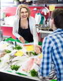 Man purchasing chilled on ice fish in supermarket Stock Images