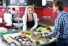Man purchasing chilled on ice fish in supermarket Royalty Free Stock Image