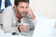 Man purchasing goods online Royalty Free Stock Photos